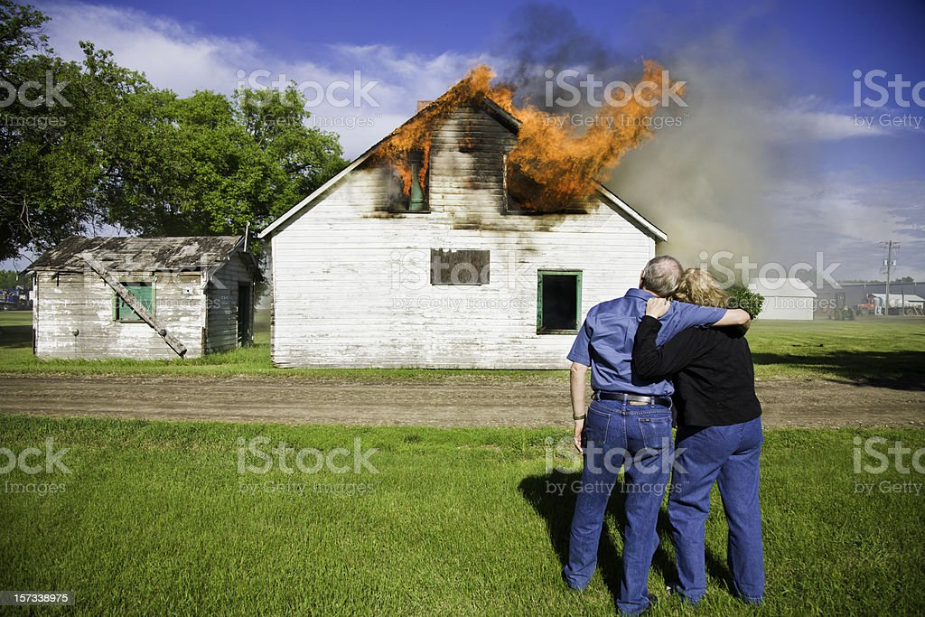 Couple's House on Fire stock photo