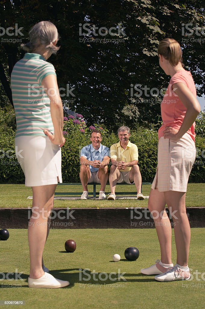 Couples lawn bowling stock photo