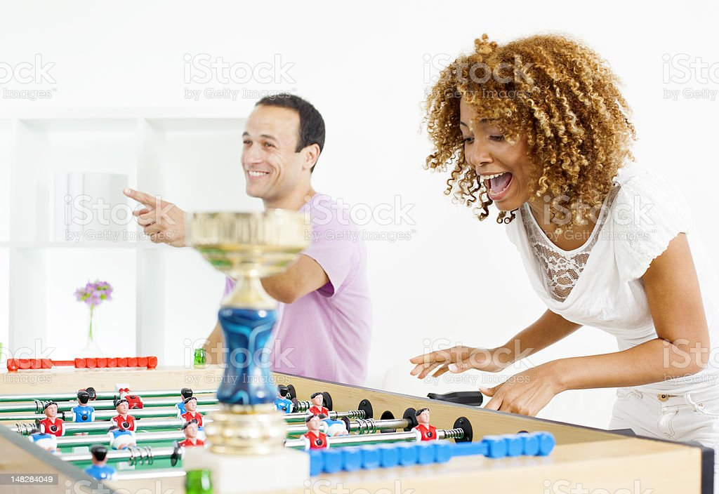 Couples Playing Foosball. royalty-free stock photo