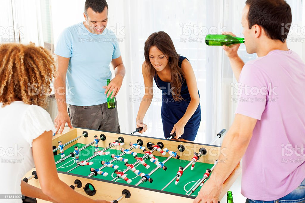 Couples Playing Foosball. stock photo