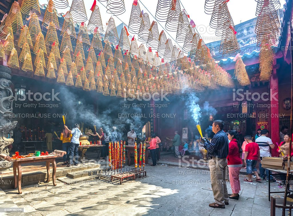 Couples pray for peace in Lunar New Year Day stock photo