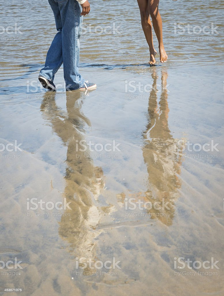 Couples reflections on beach stock photo
