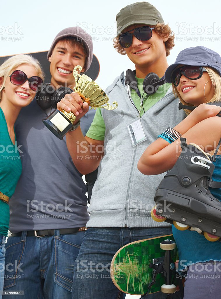 Couples standing together with award and smiling royalty-free stock photo