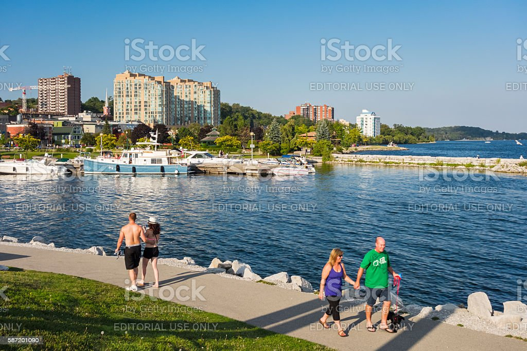 Couples Walk at Waterfront Promenade in Barrie Ontario Canada stock photo