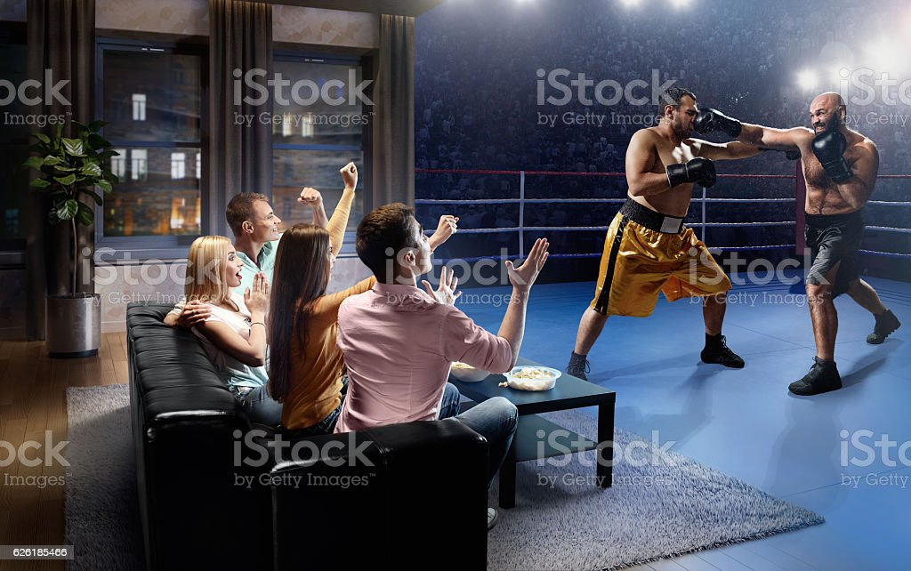 Couples watching Boxing at home stock photo