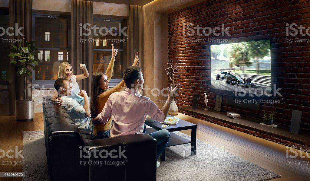 Couples watching Car sprint at home stock photo