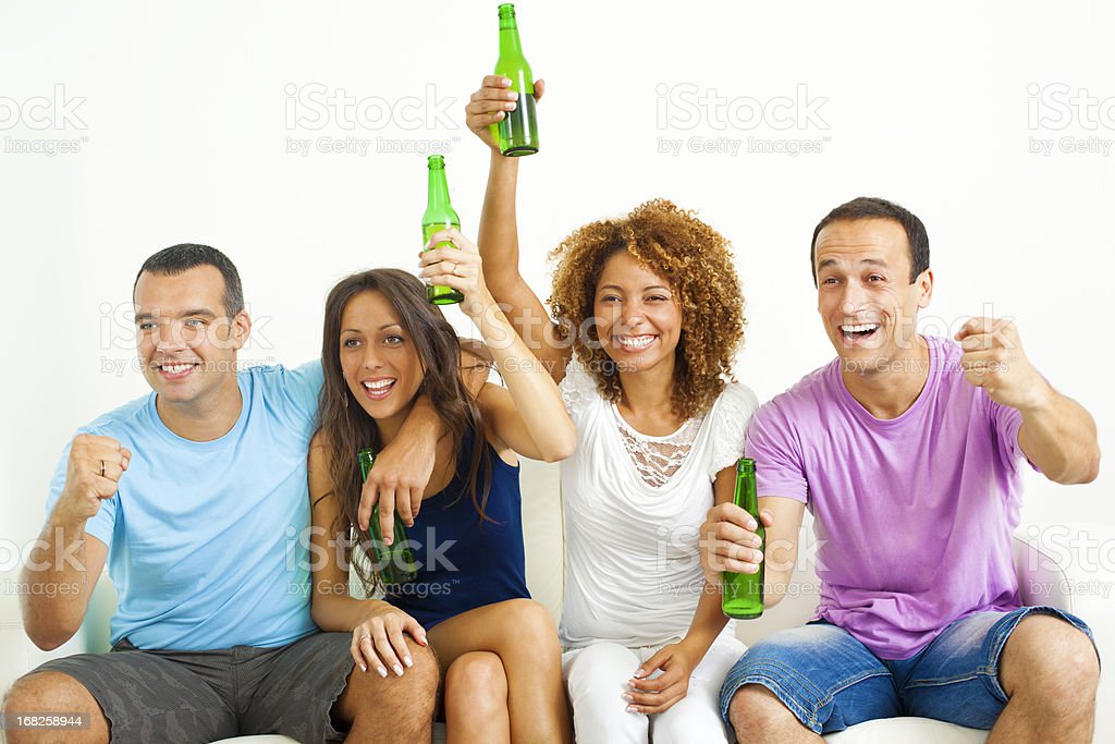 Couples watching sport on tv. royalty-free stock photo
