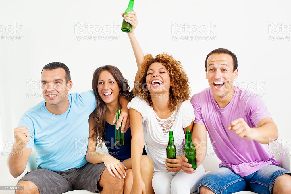 Couples watching sport on tv. stock photo