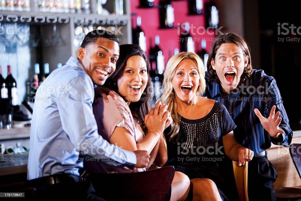 Couples watching sports at bar stock photo