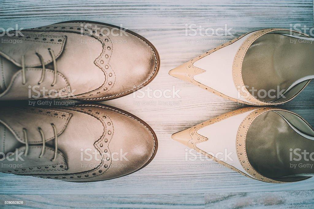 Couple's wedding shoes on hardwood stock photo