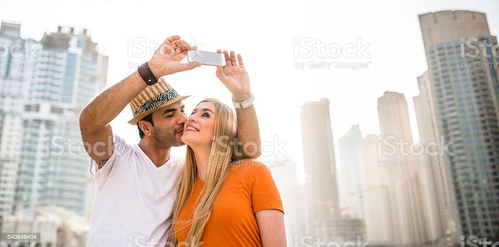 coupletake a selfie against the skyline of dubai marina stock photo