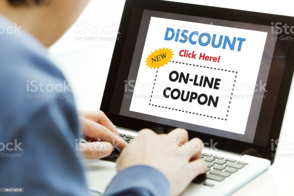 Coupon Sale—Man Using Laptop Computer, Searching Internet Discount Shopping royalty-free stock photo