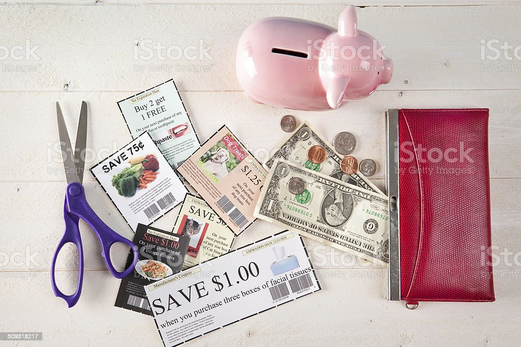 Coupons Equal Money For The Piggy Bank stock photo