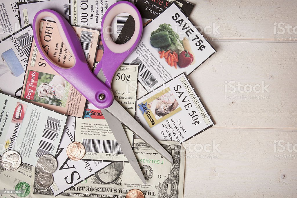 Coupons Pile With Scissors stock photo