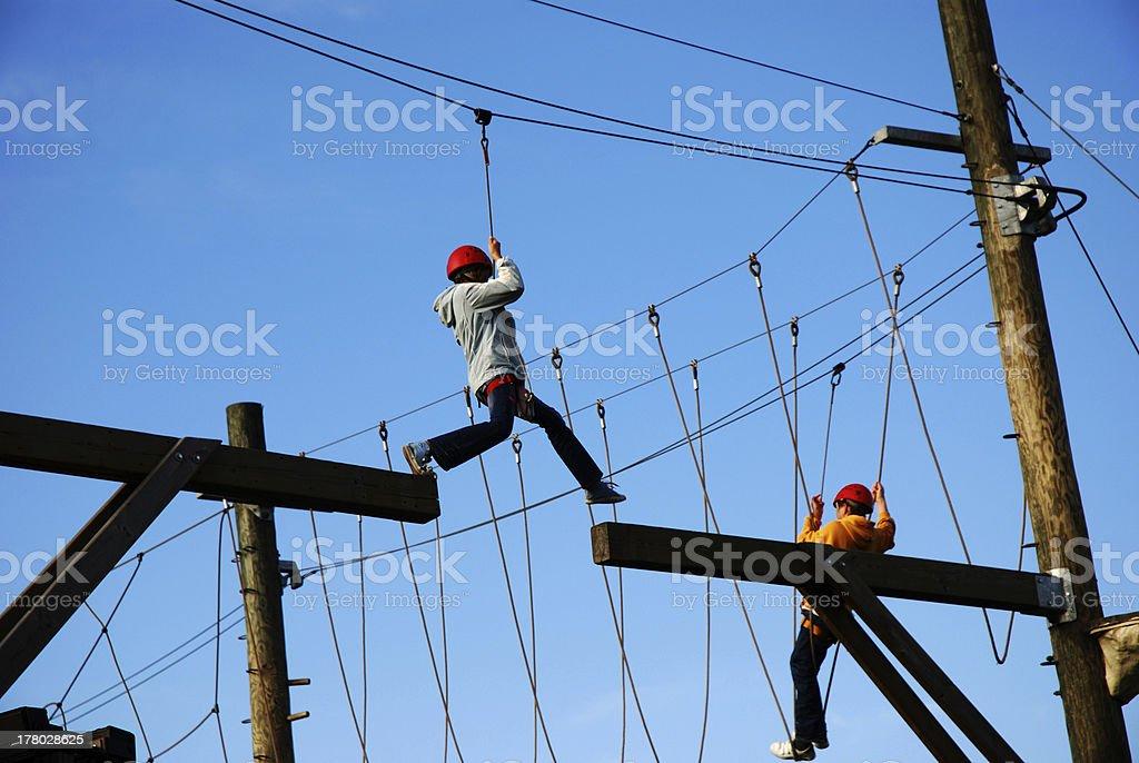 Courageous boy making a far risky jump stock photo