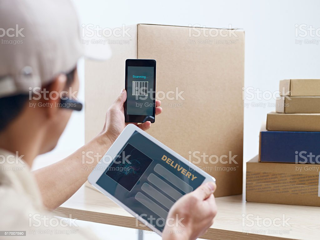 courier company worker at work stock photo