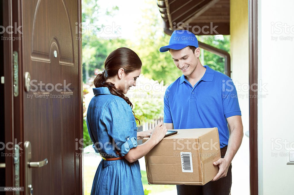 Courier delivering package stock photo