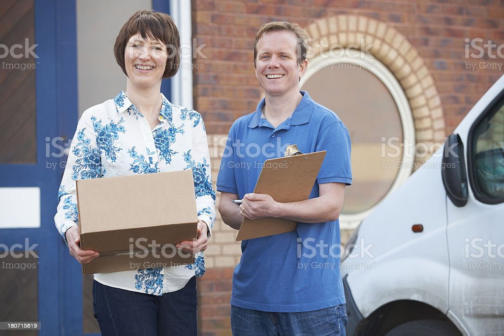Courier Delivering Package To Client royalty-free stock photo
