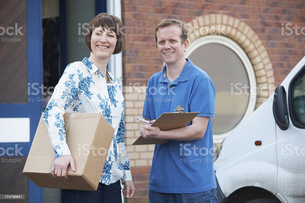 Courier Delivering Package To Customer royalty-free stock photo