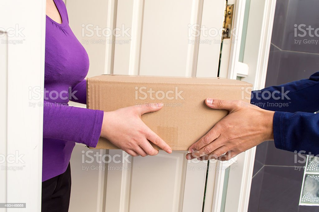 courier delivering the postal packet stock photo
