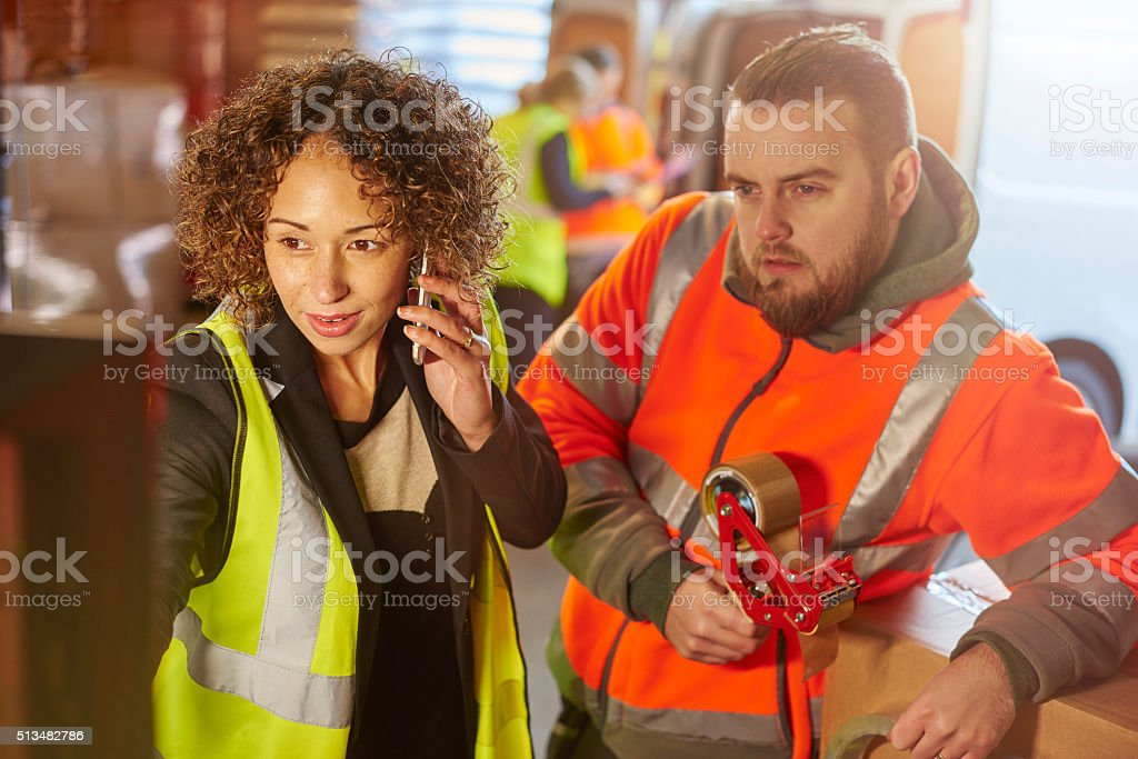 courier despatch manager stock photo