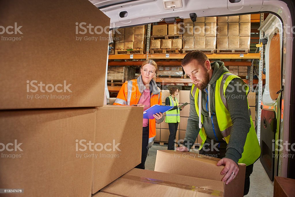 courier filling his van stock photo