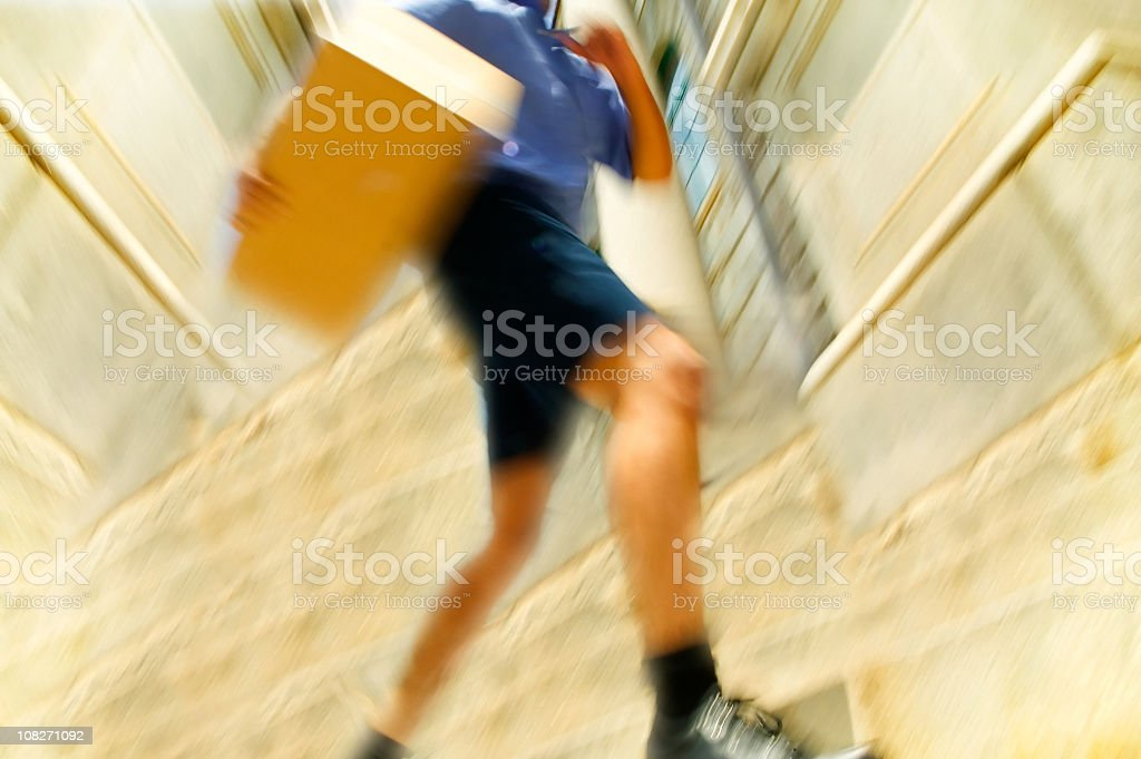 Courier Running with Package stock photo