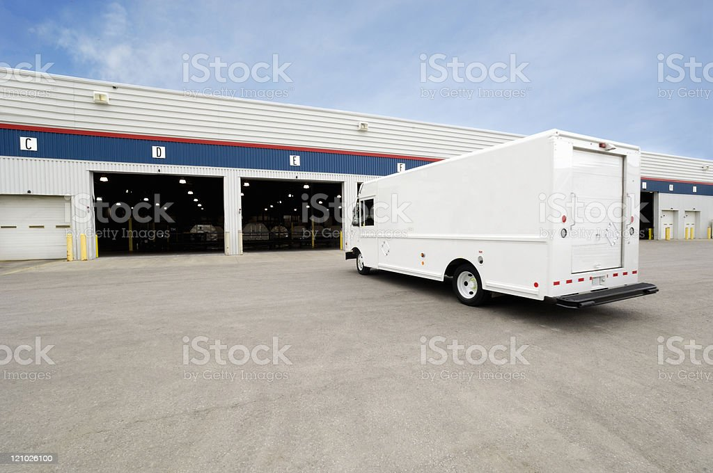 Courier terminal and delivery van stock photo
