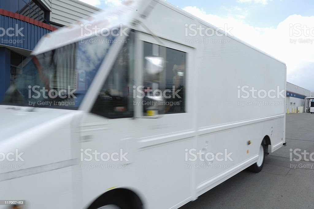 Courier vehicle leaving a distribution centre royalty-free stock photo