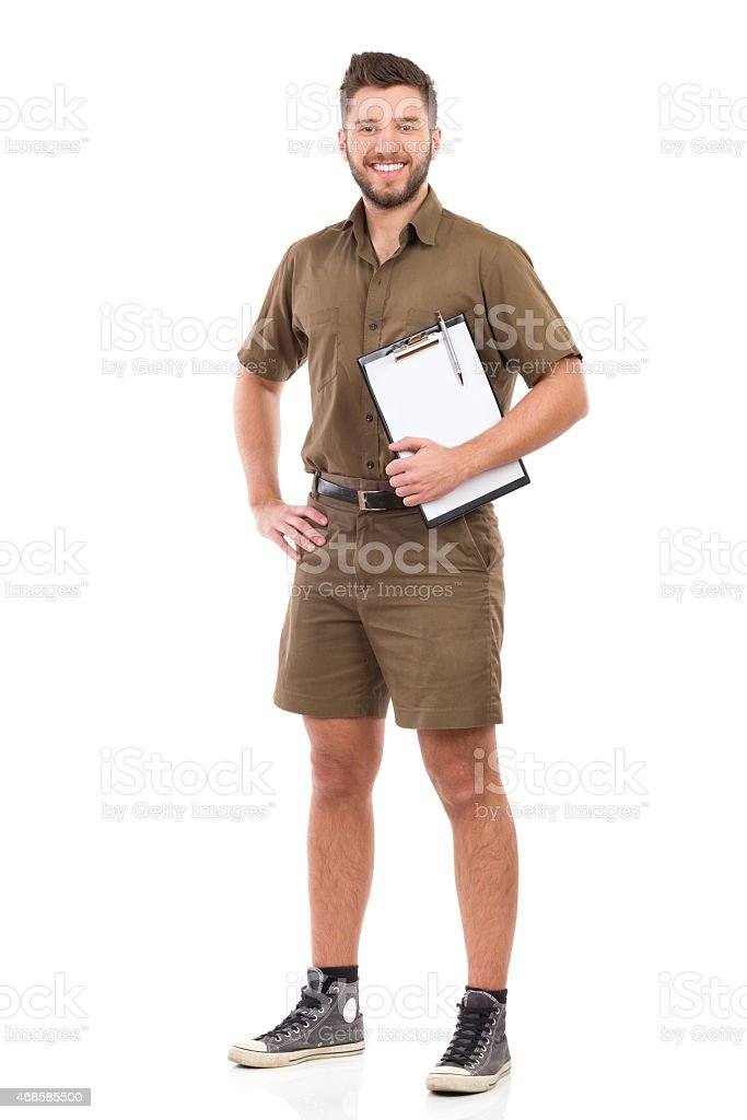 Courier waiting with a clipboard stock photo