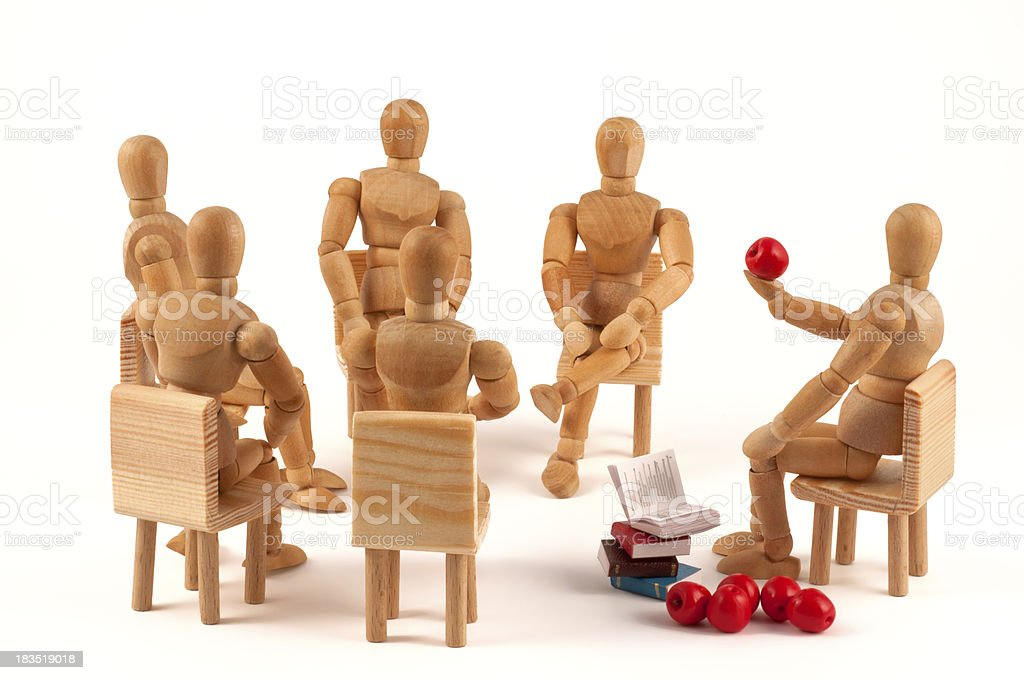 Course of healthy food - wooden mannequins listening stock photo