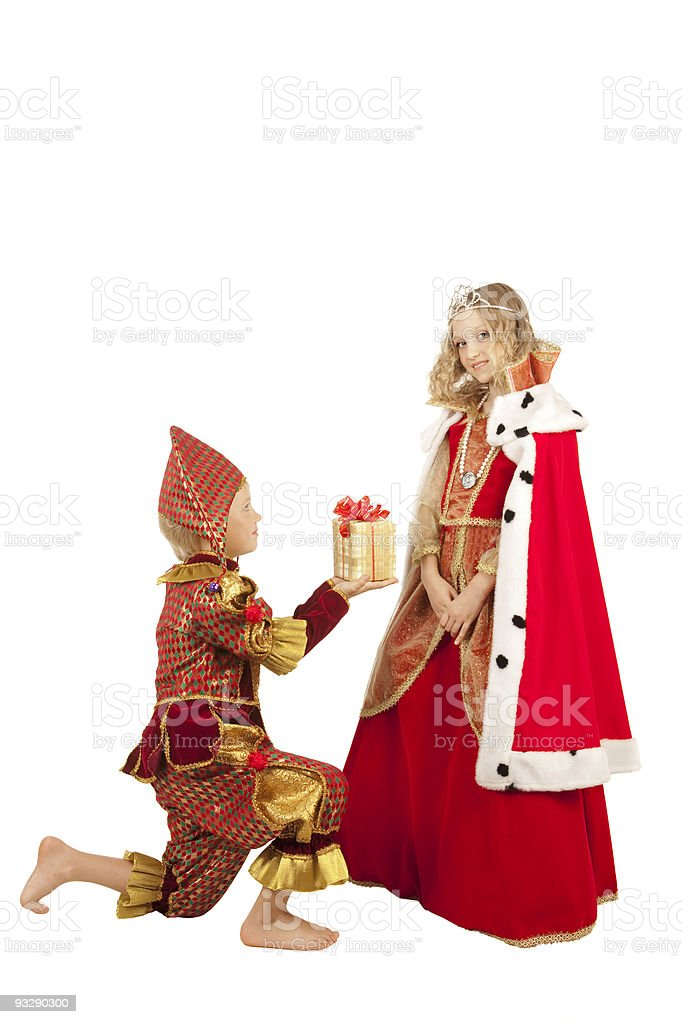 Court clown giving a present to the oueen. royalty-free stock photo