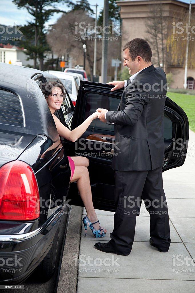 Courteous: Man Helps Woman Exit Limousine royalty-free stock photo