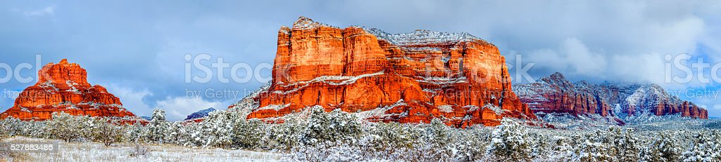 Courthouse Butte and Bell Rock under snow stock photo