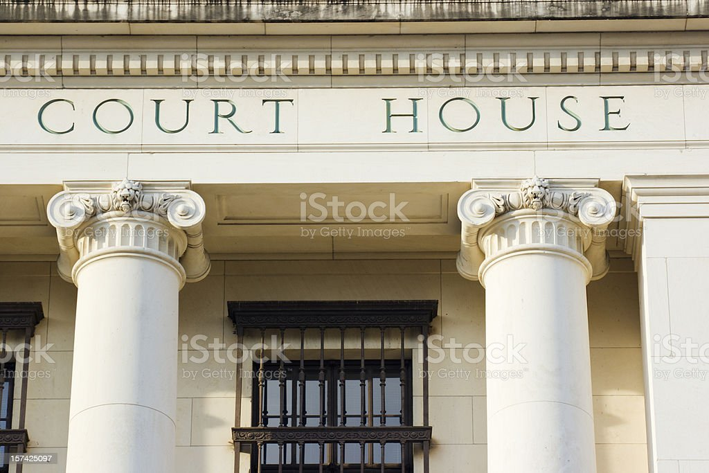 Courthouse Sign and Architectural Columns of Legal System Building Exterior stock photo