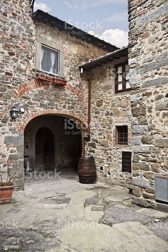 Courtyard in a Tuscan Village of Stone, Chianti Region royalty-free stock photo