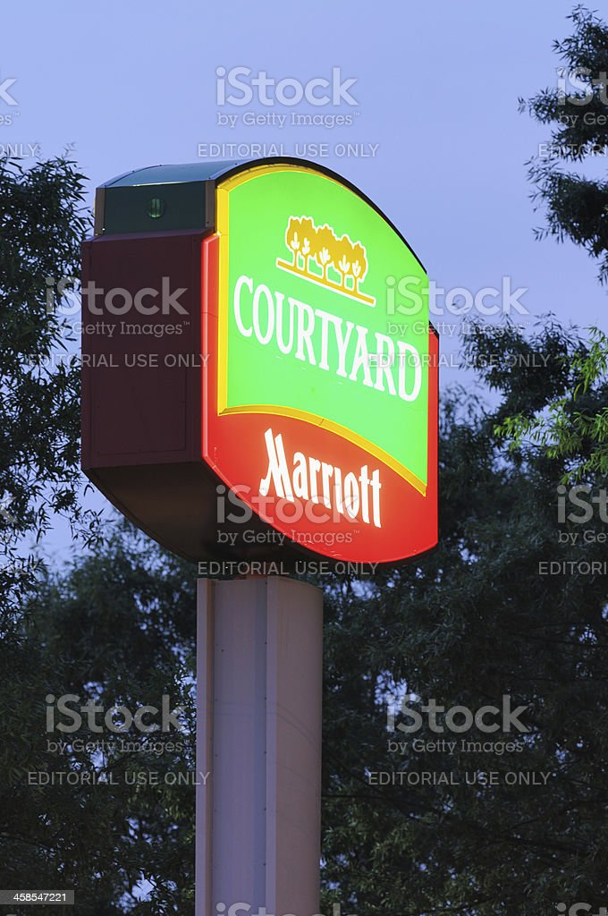 Courtyard Marriott sign at dusk stock photo