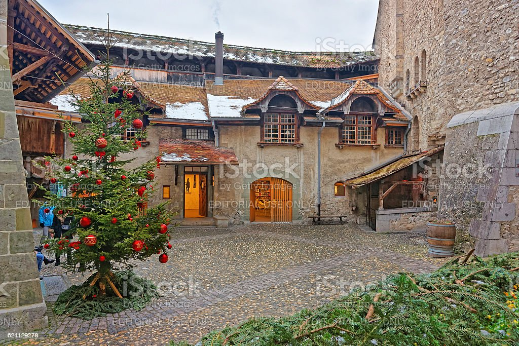 Courtyard of Chillon Castle with Christmas tree stock photo