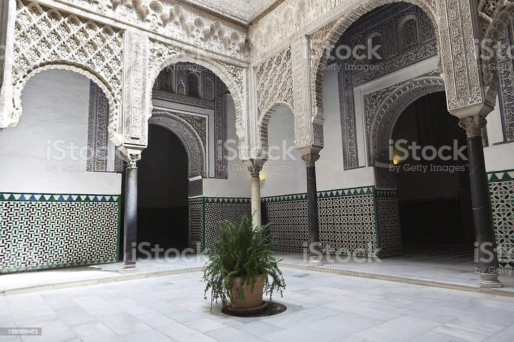 Courtyard of the Reales Alcazares, Sevilla royalty-free stock photo