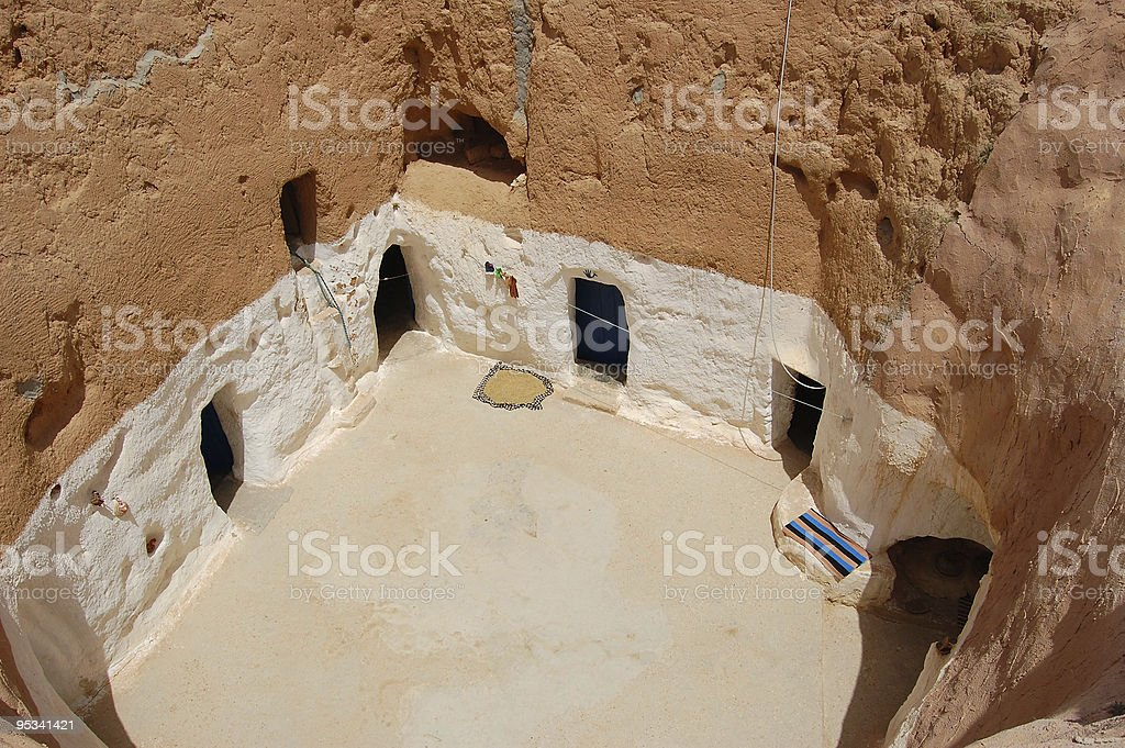 Courtyard of troglodyte cave. stock photo