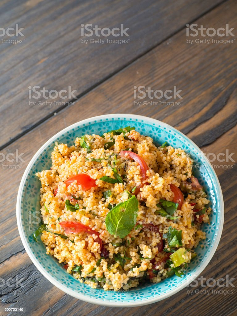 Couscous salad in a bowl with copy space stock photo