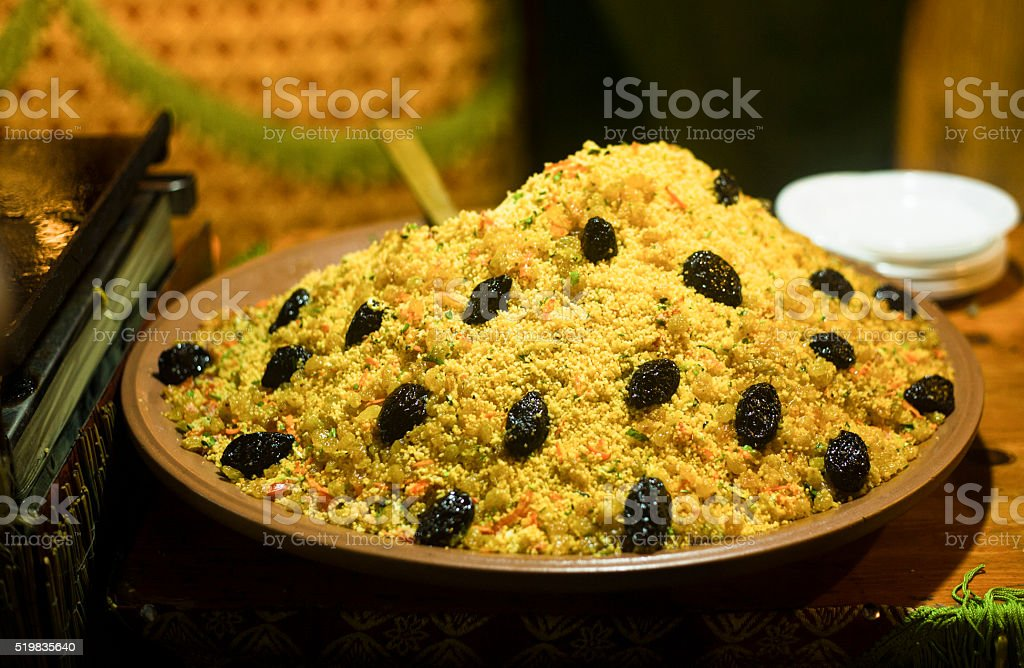 Couscous with dried plums stock photo
