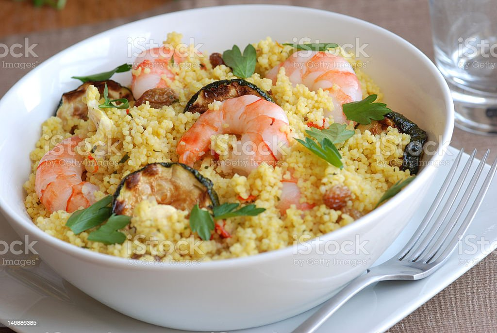 Couscous with prawns and courgette royalty-free stock photo