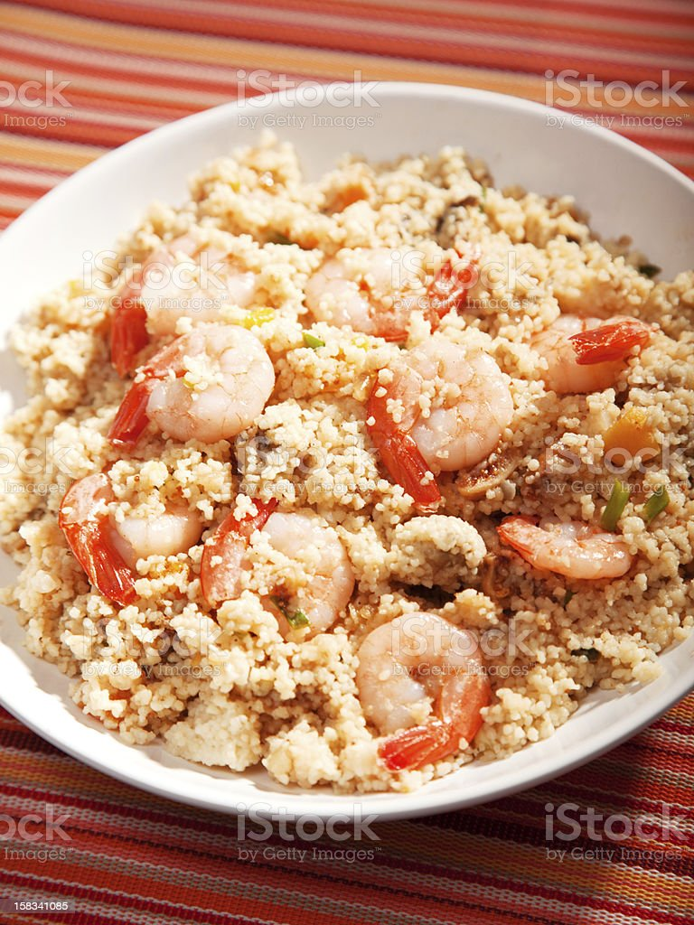Couscous with shrimps and dried apricots royalty-free stock photo