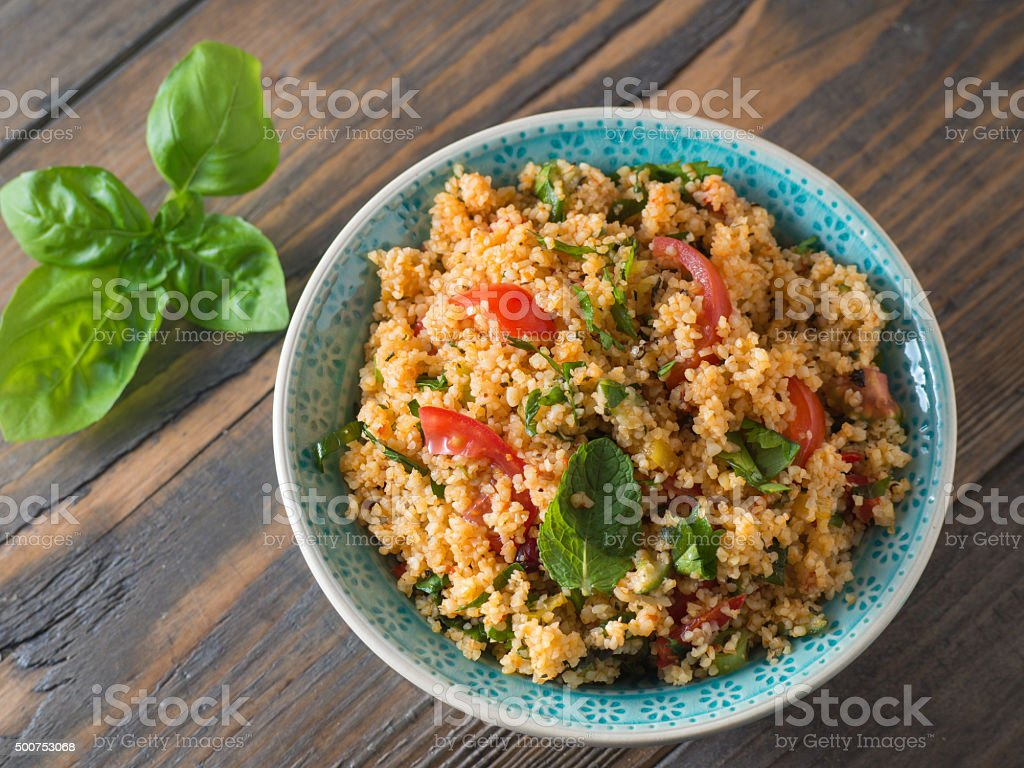 Couscous with tomatoes and basil stock photo