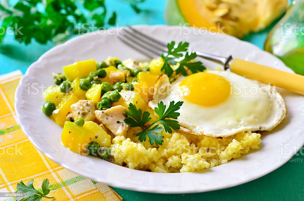 Couscous,vegetable ragout and fried egg stock photo