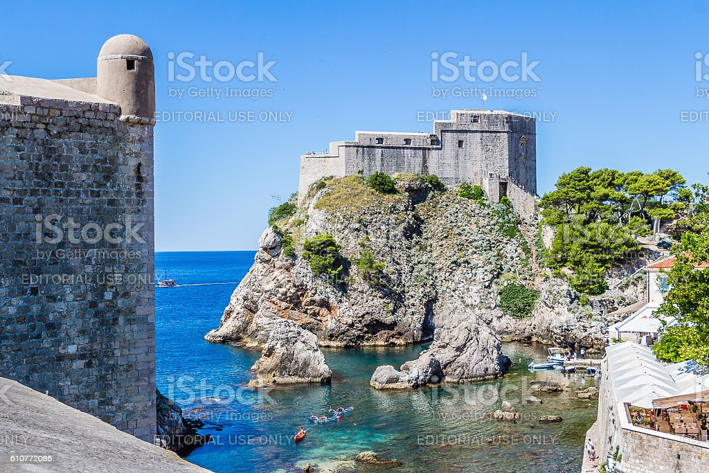 Cove, city wall tower and Fort Lovrijenac in Dubrovnik, Croatia stock photo