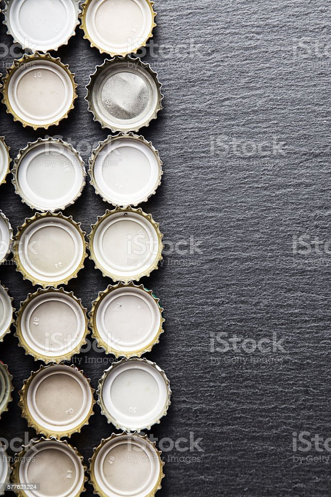 Cover of beer on slate blackboard, top view stock photo