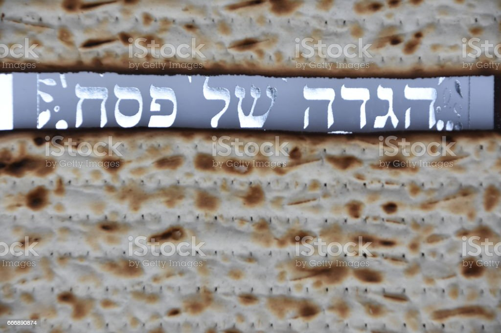 Cover of the Passover Haggadah  Between two matzot stock photo
