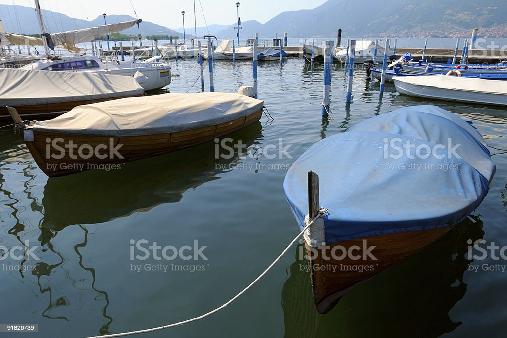 Covered boats moored in the marina at Iseo, Lombardy, Italy royalty-free stock photo